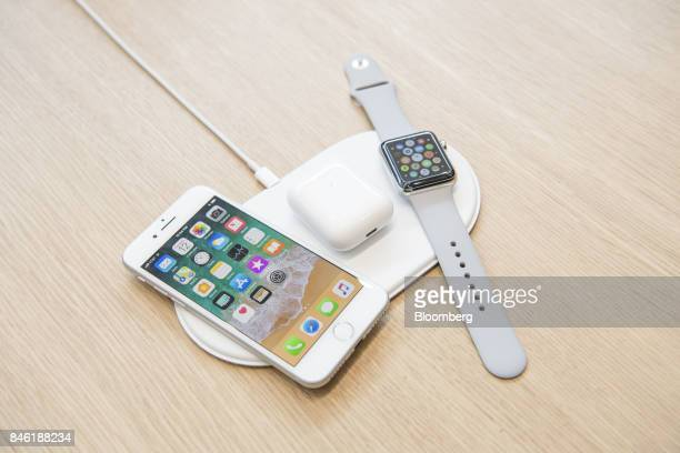 The Apple Inc iPhone 8 Airpods and Apple Watch sit on the AirPower charger during an event at the Steve Jobs Theater in Cupertino California US on...