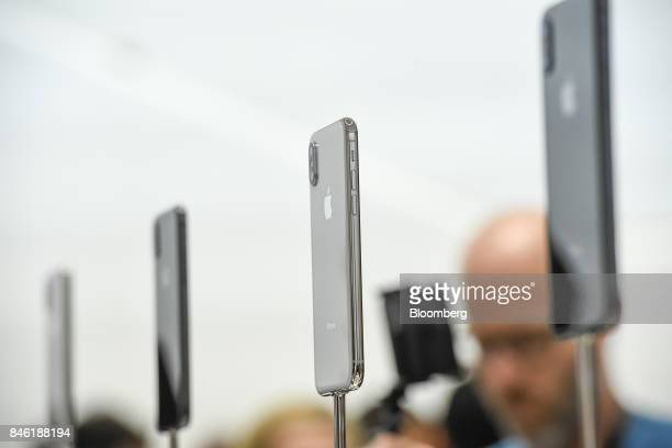 The Apple Inc iPhone X is displayed during an event at the Steve Jobs Theater in Cupertino California US on Tuesday Sept 12 2017 Apple Inc unveiled...
