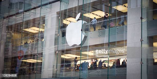 The Apple Inc logo hangs on the facade of the company's store in Sydney Australia on Thursday Oct 6 2011 Steve Jobs cofounder and former chief...