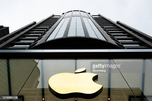 The Apple Inc logo is displayed at one of the company's stores in Hong Kong China on Thursday Jan 3 2019 Apple cut its revenue outlook for the first...