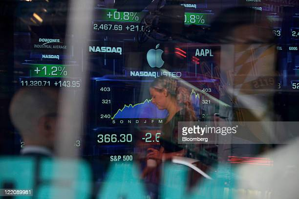 The Apple Inc logo is displayed at the Nasdaq MarketSite just before the opening trading bell in New York US on Thursday Aug 25 2011 Steve Jobs...