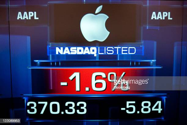 The Apple Inc logo is displayed at the Nasdaq MarketSite shortly after the opening trading bell in New York US on Thursday Aug 25 2011 Steve Jobs...