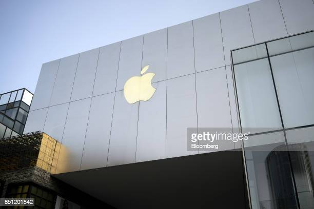 The Apple Inc logo is displayed outside the Apple Store at Sanlitun in Beijing China on Friday Sept 22 2017 Consumers preordered about 15 million...