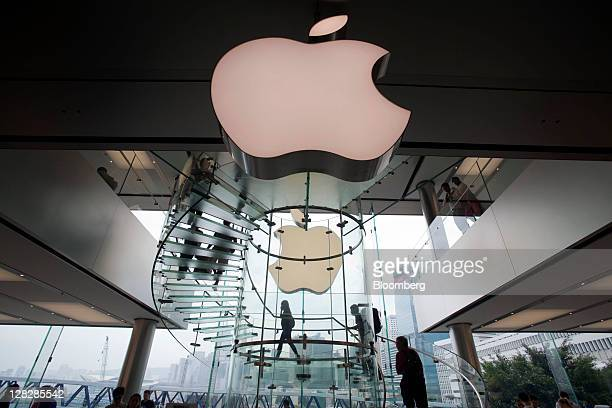 The Apple Inc logo is displayed outside the company's store in Hong Kong China on Thursday Oct 6 2011 Steve Jobs cofounder and former chief executive...