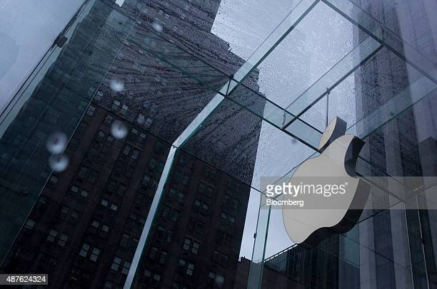 The Apple Inc logo is seen at the entrance to a store as it rains in New York US on Thursday Sept 10 2015 Apple Inc unveiled a wideranging lineup of...