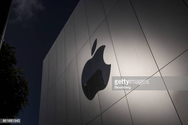 The Apple Inc logo is seen on the front of the store during the sales launch of the Apple Inc iPhone 8 smartphone Apple watch series 3 device and...