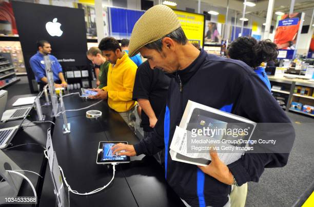 Scott Varley The Apple iPad went on sale Saturday morning across the country and more that a dozen shoppers at the Torrance Best Buy lined up an hour...