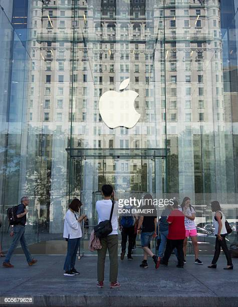 The Apple logo at the entrance to the Fifth Ave. Apple store September 14, 2016 in New York. The iPhone 7 and larger iPhone 7 Plus, with...