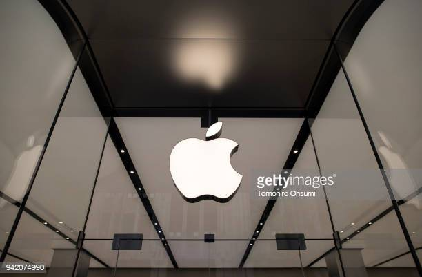 The Apple logo hangs above the entrance to the Apple Shinjuku store on April 5 2018 in Tokyo Japan Apple Japan held a preview of the new store for...