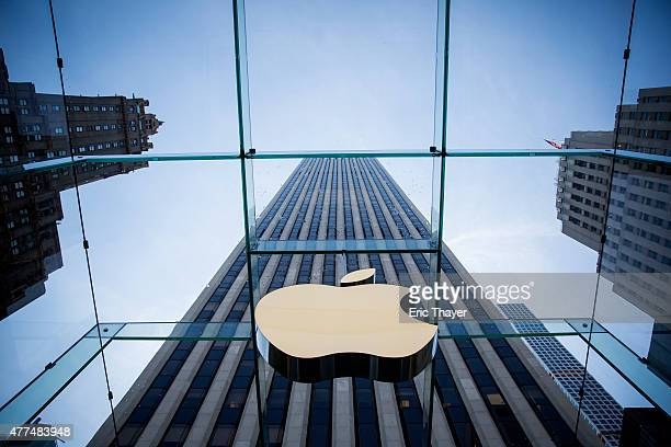 The Apple logo is displayed at the Apple Store June 17, 2015 on Fifth Avenue in New York City. The company began selling the watch in stores...