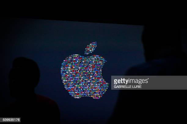 The Apple logo is displayed on a screen at Apple's annual Worldwide Developers Conference presentation at the Bill Graham Civic Auditorium in San...