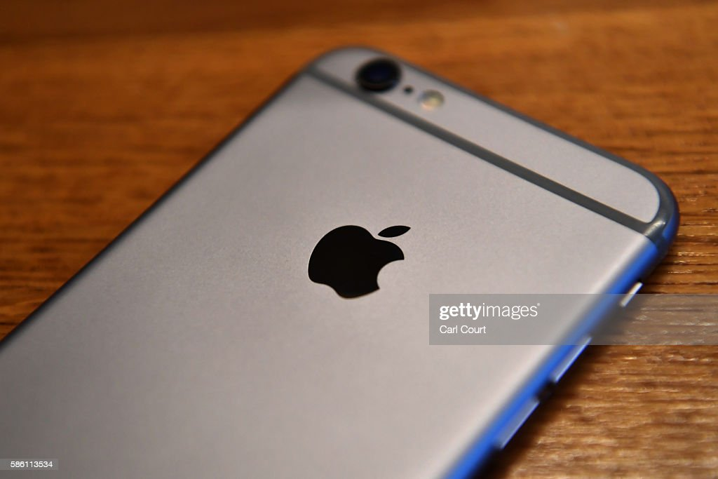 The Apple logo is displayed on the back of an iPhone on August 3, 2016 in London, England.