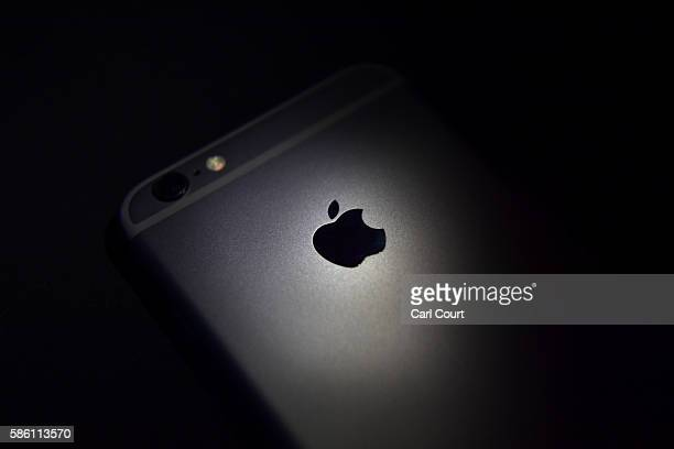 The Apple logo is displayed on the back of an iPhone on August 3 2016 in London England