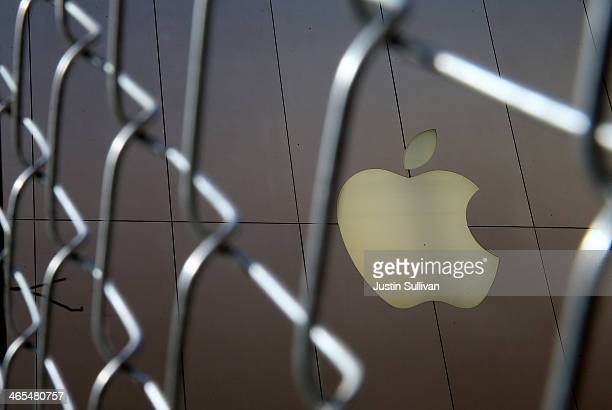 The Apple logo is displayed on the exterior of an Apple Store on January 27 2014 in San Francisco California Apple will report quarterly earnings...