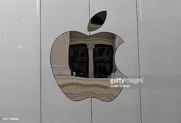 The Apple logo is displayed on the exterior of the new flagship Apple Store on May 19 2016 in San Francisco California Apple is preparing to open its...