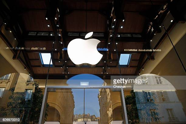 The Apple logo is displayed on the facade of the new Apple store Saint Germain during the press day on December 01 2016 in Paris France On December 3...