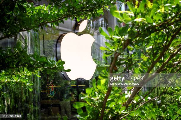 The Apple logo is pictured outside the newly-opened Apple store in downtown Bangkok on July 31, 2020.