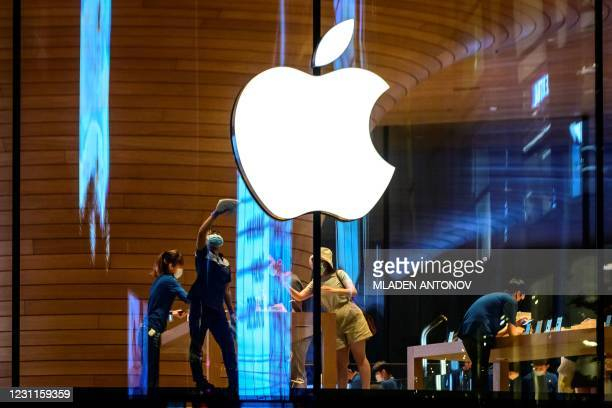 The Apple logo is seen on a window of the company's store in Bangkok on February 14, 2021.