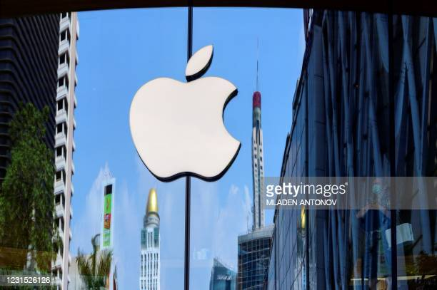 The Apple logo is seen on a window of the company's store in Bangkok on March 5, 2021.