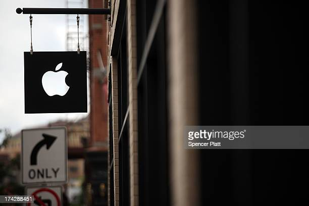 The Apple logo is viewed in front of an Apple store on July 23 2013 in New York City Apple is due to report thirdquarter earnings after the markets...