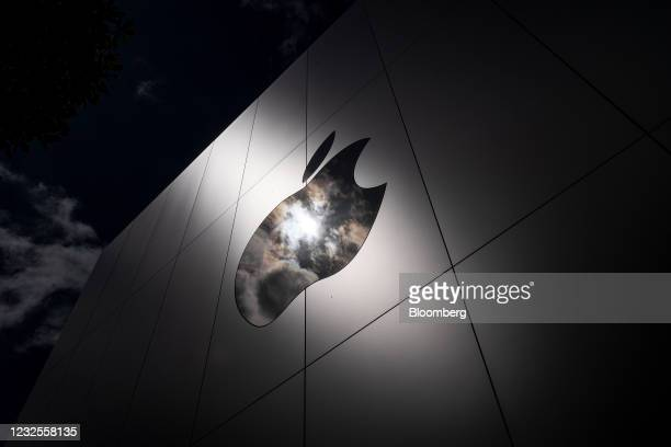 The Apple logo on a store in San Francisco, California, U.S., on Monday, April 26, 2021. Apple Inc. Is increasing its U.S. Investments by 20% over...