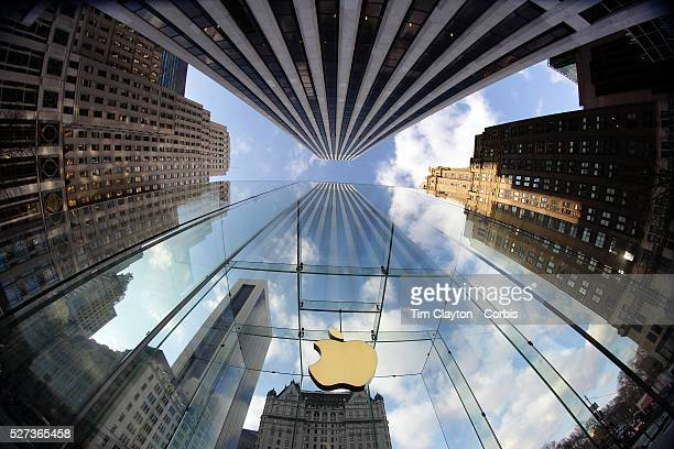 The Apple Logo on the glass fronted Apple Store surrounded by the high rise buildings of Manhattan opposite Central Park on Fifth Avenue Manhattan...