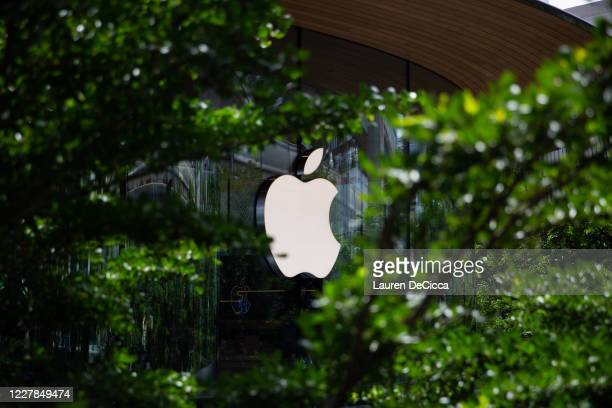 The Apple logo shining on the front of Apple Central World on the stores opening day on July 31, 2020 in Bangkok, Thailand. Apple's second, and...