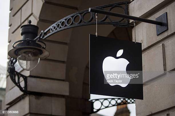 The Apple logo sits on a sign outside company's Covent Garden store on September 29 2016 in London England Technology company Apple has announced...