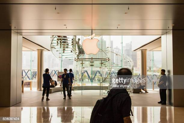 the apple store in the international finance center shopping mall in hong kong - apple computers stock pictures, royalty-free photos & images