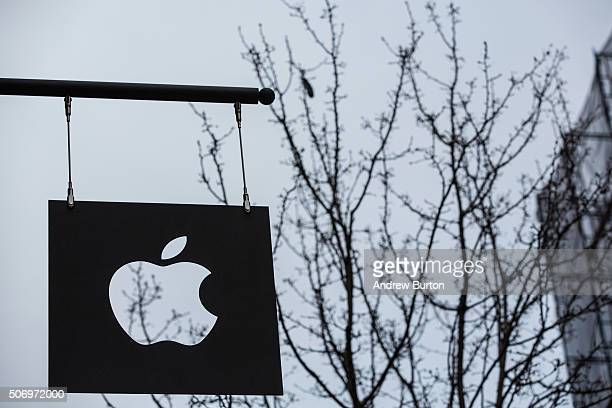 The Apple store in the SoHo neighborhood is seen on January 26 2016 in New York City This afternoon Apple reported the slowest iPhone earnings since...