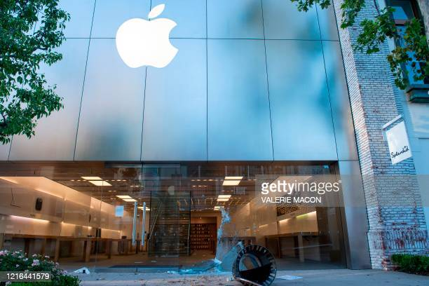 The Apple store window is destroyed at the Grove shopping center in the Fairfax District of Los Angeles on May 30, 2020 following a protest against...
