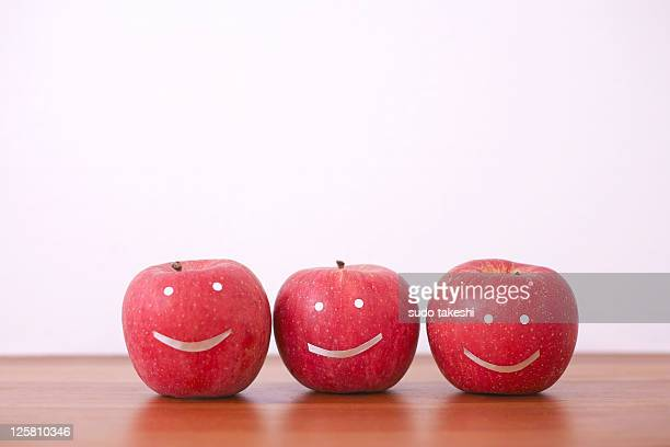 The apples that have been painted face.