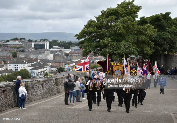 The Apprentice Boys colour party lead the parade along Derry's walls as the Apprentice Boys of Derry take part in the annual Relief of Derry march on...