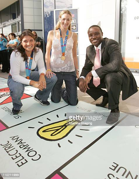 The Apprentice' runner-up Kwame Jackson poses with 2004 Olympic Beach Volleyball Gold medallists Misty May and Kerri Walsh after playing MONOPOLY on...