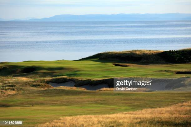 The approach to the green on the par 5 10th hole with the island of Arran in the distance on the Ailsa Course at the Trump Turnberry Resort on July...
