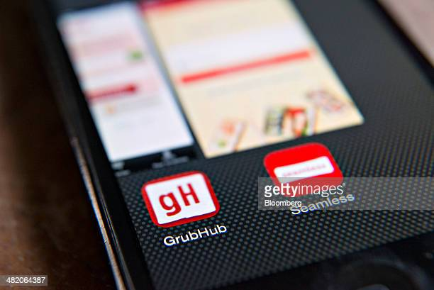 The apps for GrubHub Inc and Seamless are displayed on an Apple Inc iPhone 5 in Tiskilwa Illinois US on Wednesday April 2 2014 GrubHub Inc the...