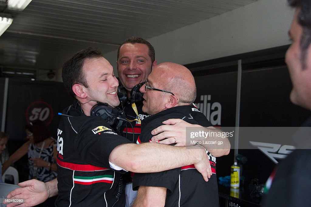 The Aprilia Racing Team mechanics celebrate in box at the end of race 2 during the first round of the 2013 Superbike FIM World Championship at Phillip Island Grand Prix Circuit on February 24, 2013 in Phillip Island, Australia.