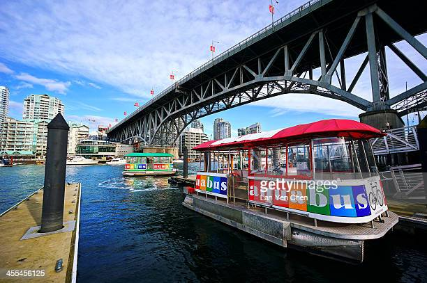 CONTENT] The Aquabus with rainbow colors is a ferry service along False Creek in Vancouver BC Canada