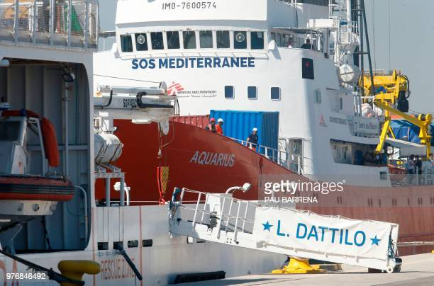 The Aquarius rescue ship docks behind the Italian coast guard boat the Dattilo at the port of Valencia on June 17 2018 The 630 migrants whose rescue...