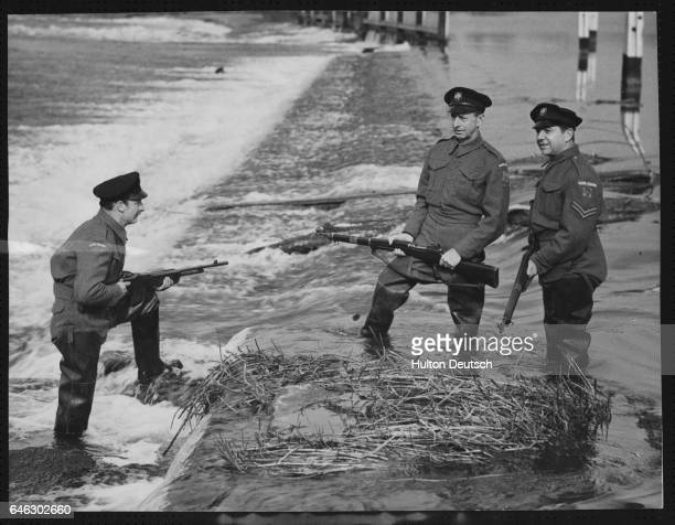 The Aquatic Home Guard Guarding the weirs and lock gates is cheerfully undertaken by the HQ in spite of physical discomfort and long hours A...