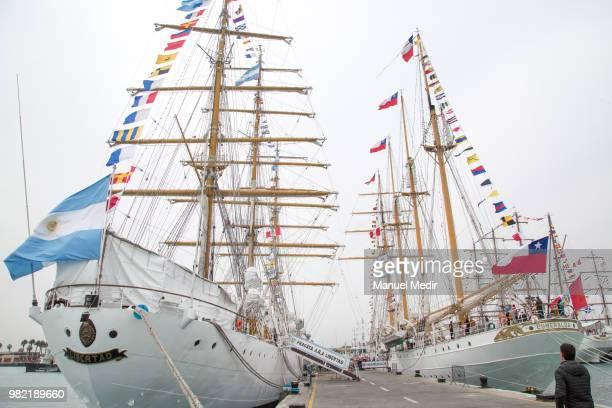 The ARA Libertad sailing ship school vessel of the Argentine Navy and the Esmeralda barquentine tall ship of the Chilean Navy are seen side by side...