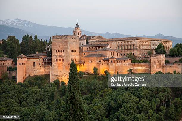 The Arab fortress of Alhambra at sunset The Alhambra is a palace and fortress complex located in Granada Andalusia Spain The Alhambra's Islamic...