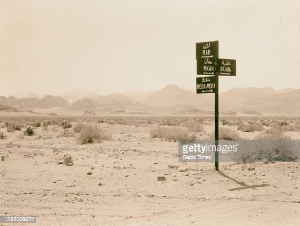The Araba . Negeb el-Shurk. Akaba . Gulf of Akaba and el-Kuntilla. Araba. Traffic sign near Ibn Saoud boundary, indicating direction to Wadi Rum,...