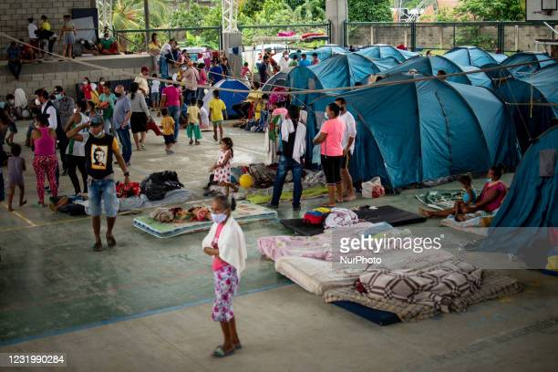 The Arauca River in Arauquita, Colombia on March 28, 2021 is the scene in which families from the Venezuelan municipality of La Victoria cross in...