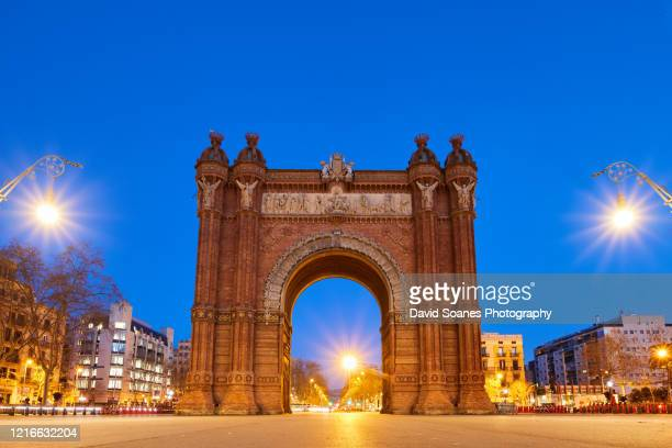 the arc de triomf at dawn in barcelona, spain - monument stock pictures, royalty-free photos & images