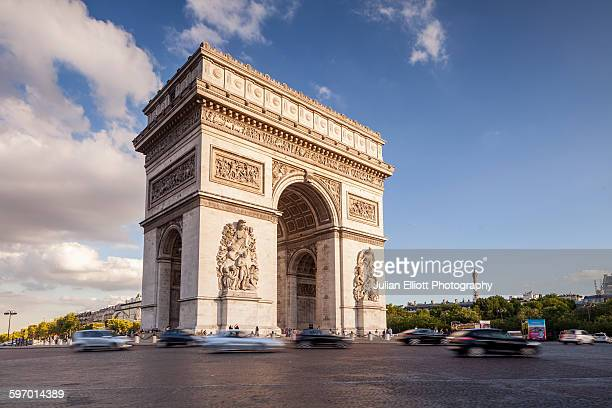 the arc de triomphe and place charles de gaulle - triumphal arch stock photos and pictures