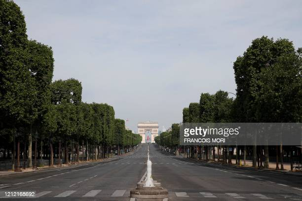 The Arc de Triomphe and the empty Champs Elysees avenue are pictured ahead of the start of the ceremony marking the 75th anniversary of World War II...
