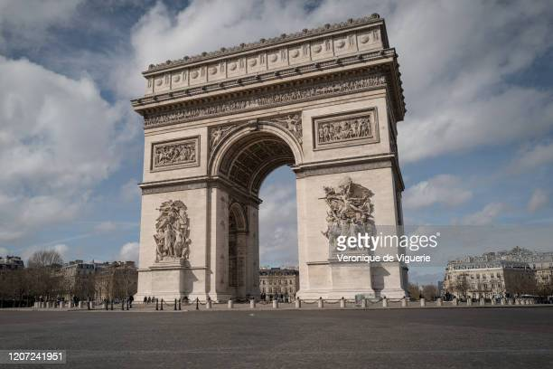 The Arc de Triomphe is deserted on March 15, 2020 in Paris, France. French President Emmanuel Macron has declared a ban on all gathering of more than...