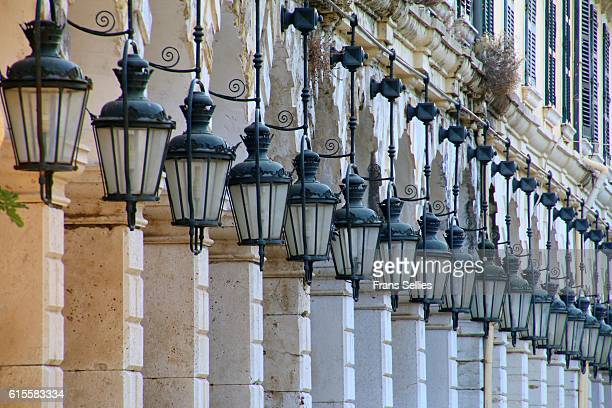 The arcades and traditional lanterns of the famous Liston at the Spianada in Kerkyra, Corfu Town, Greece