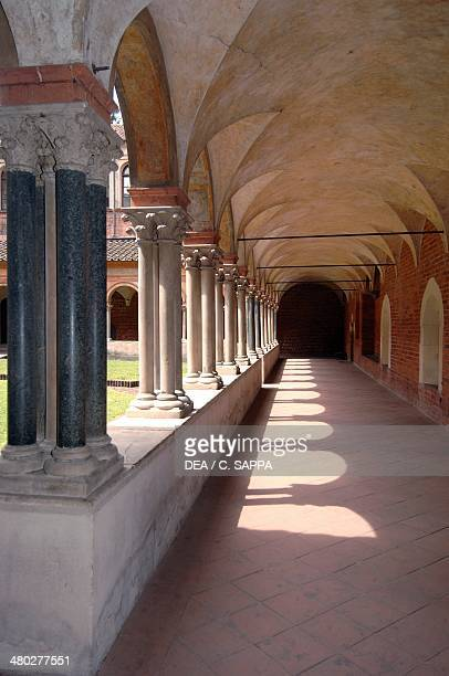The arcades of the cloister supported by groups of four columns on a single base Basilica of Sant'Andrea Vercelli Piedmont Italy